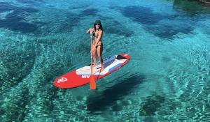 Woman paddle-boarding in Ibiza