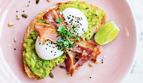 A poached egg, bacon and avocado on toast